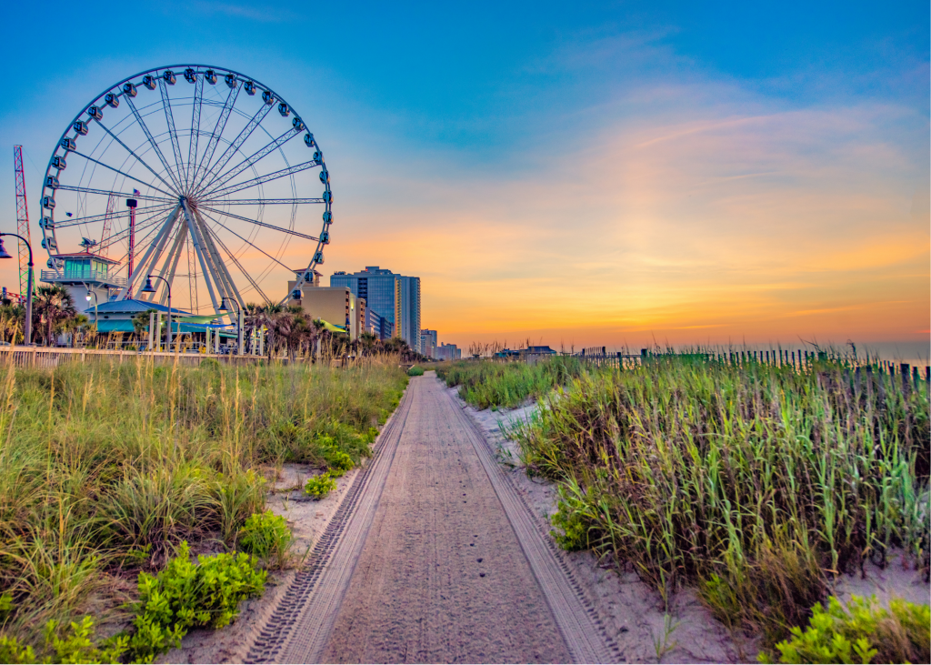 Sand, dunes and Myrtle Beach SkyWheel in the background