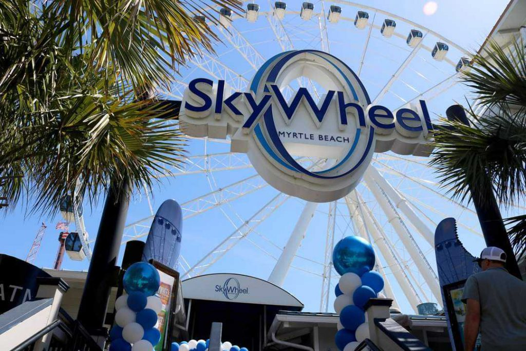 Picture of Myrtle Beach SkyWheel Entrance Sign and SkyWheel in background