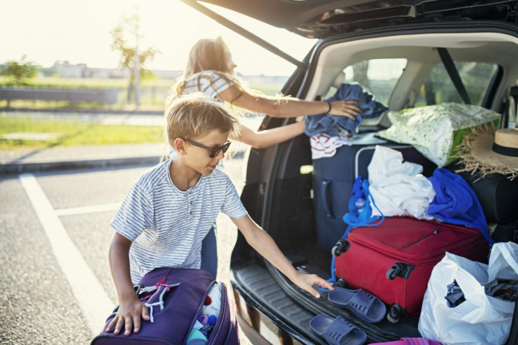 family unloading vehicle on vacation